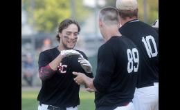 HCHS junior Brett Sears is congratulated by teammates Ryan Doran (89) and Derec Weyer (10) after hitting the first of his two home runs during Wednesday's 8-3 win over Council Bluffs Thomas Jefferson.