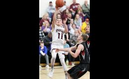 Exira-EHK senior point guard Cole Burmeister (11) shoots against Rolling Valley Conference rival Ar-We-Va during a regular season home game. Burmeister was named second team All-State by the IPSWA.