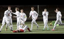 THE THRILL...AND THE AGONY -- Harlan Community players celebrate Monday's game-winning overtime goal by Dylan Eshelman (3) as two Kuemper Catholic opponents fall to the ground in frustration following a hard-fought battle at Merrill Field. HCHS players, left-right, include: Eshelman, Jordan Fink, Tanner Fink, Cole Kramer, Drew Voge and Levi Culp. (Photos by Mike Oeffner)