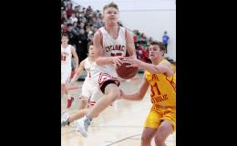 HCHS junior Hunter Manz (left) has the ball knocked away by Kuemper's Sam Auen as he attempts to score on a drive to the basket Tuesday night. Manz finished with four points as the Cyclones won 74-60.