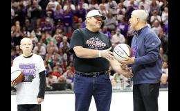 Jim Stessman of Harlan (center) is presented with a commemorative Iowa Farm Bureau basketball by Todd Tharp, Assistant Director of the Iowa High School Athletic Association. At left is Jesse Sellers, who was honored as Norwalk's Fan of the Game. (Photo by Mike Oeffner)