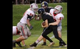 Harlan Community's Jesse Schwery (67) and Jameson Bieker (34) combine to tackle an Atlantic player during regular season action last fall. Following changes brought about by the Iowa High School Athletic Association's decision to shorten the regular season, HCHS will now open the 2020 season with non-district games vs. Grinnell and at Pella.