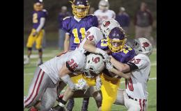 Denison-Schleswig ball carrier Dan Summers is tackled by Cyclone senior Nick Tarney (35) and sophomores Jon Owens (34) and Jake McLaughlin (83) on Friday night. HCHS held the Monarchs scoreless during the second half.