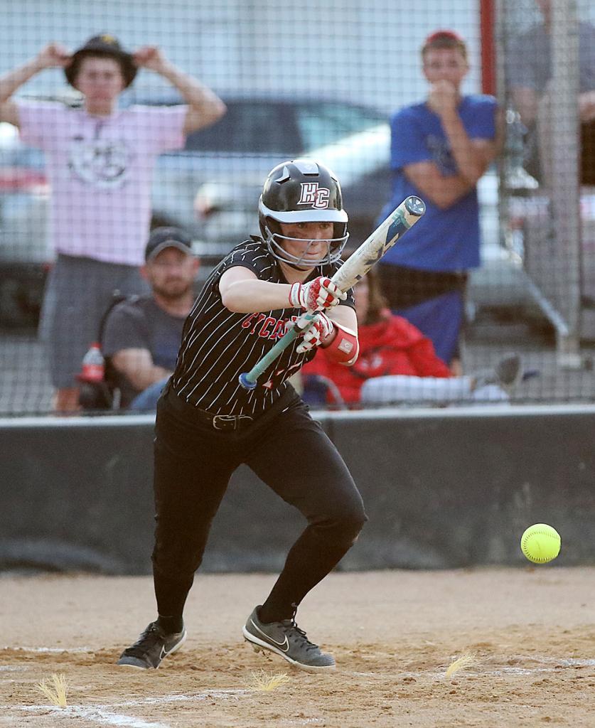 HCHS sophomore Aurora Miller puts down a sacrifice bunt. (Photos by Mike Oeffner)