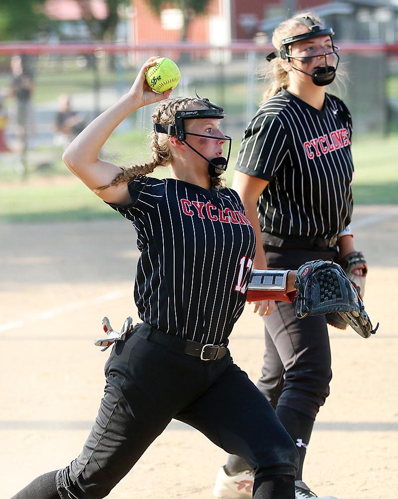 Third baseman Aurora Miller fires to first after fielding a bunt.