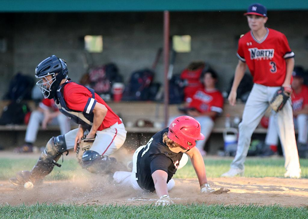 HCHS senior Isaiah Ahrenholtz slides home with the game-ending run in the Cyclones' 16-1, four-inning win over Sioux City North. HCHS took the night cap vs. the Stars to earn a doubleheader split. (Photos by Mike Oeffner)