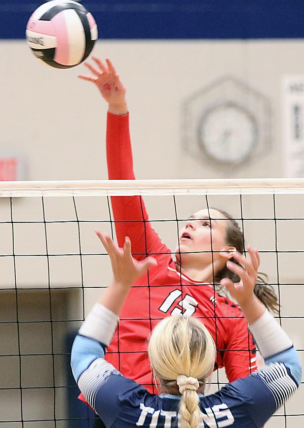 Cyclone junior middle Lauren Andersen (15) hits over Lewis Central's Lauren Payne. (Photos by Mike Oeffner)
