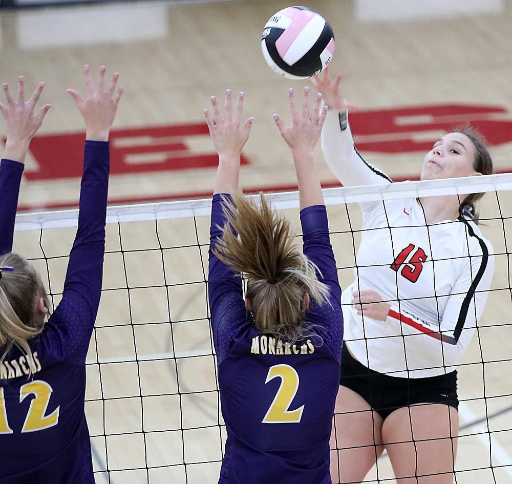 HCHS senior Lauren Andersen (15) hits over the block attempt of Denison's Kennedy Marten (2) and Paige Andersen during Tuesday's Hawkeye Ten Conference volleyball match.
