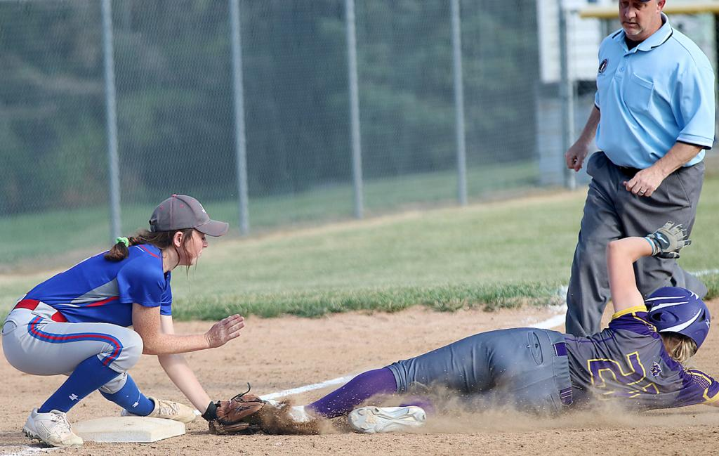 Lady Vike senior Katie Anzalone (left) tags out Logan-Magnolia's Reanna Rife at third base.