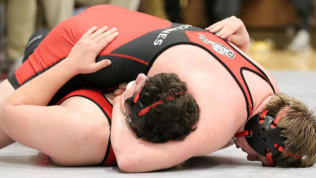 HCHS 220-pounder Joey Arkfeld pins Creston's Trevor Kinyon in their third-place final on Saturday.