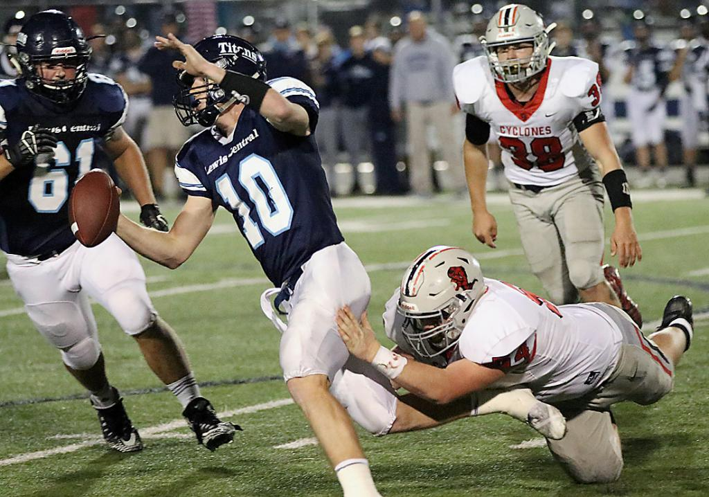 Titan quarterback Max Duggan (10) eludes the diving tackle attempt of HCHS senior Joey Arkfeld. Duggan rushed for 212 yards and four TDs. (Photos by Mike Oeffner)