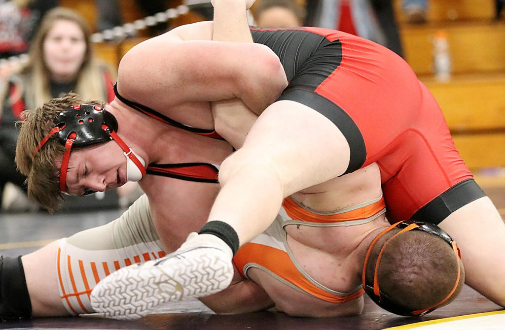 Arkfeld turns Stowe to his back before pinning him in the second period. (Photos by Mike Oeffner)