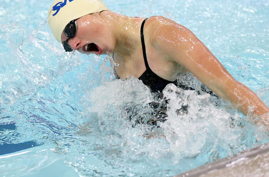 Aurora Miller makes the final turn in the 100-meter breaststroke on her way to placing second. (Photos by Mike Oeffner)