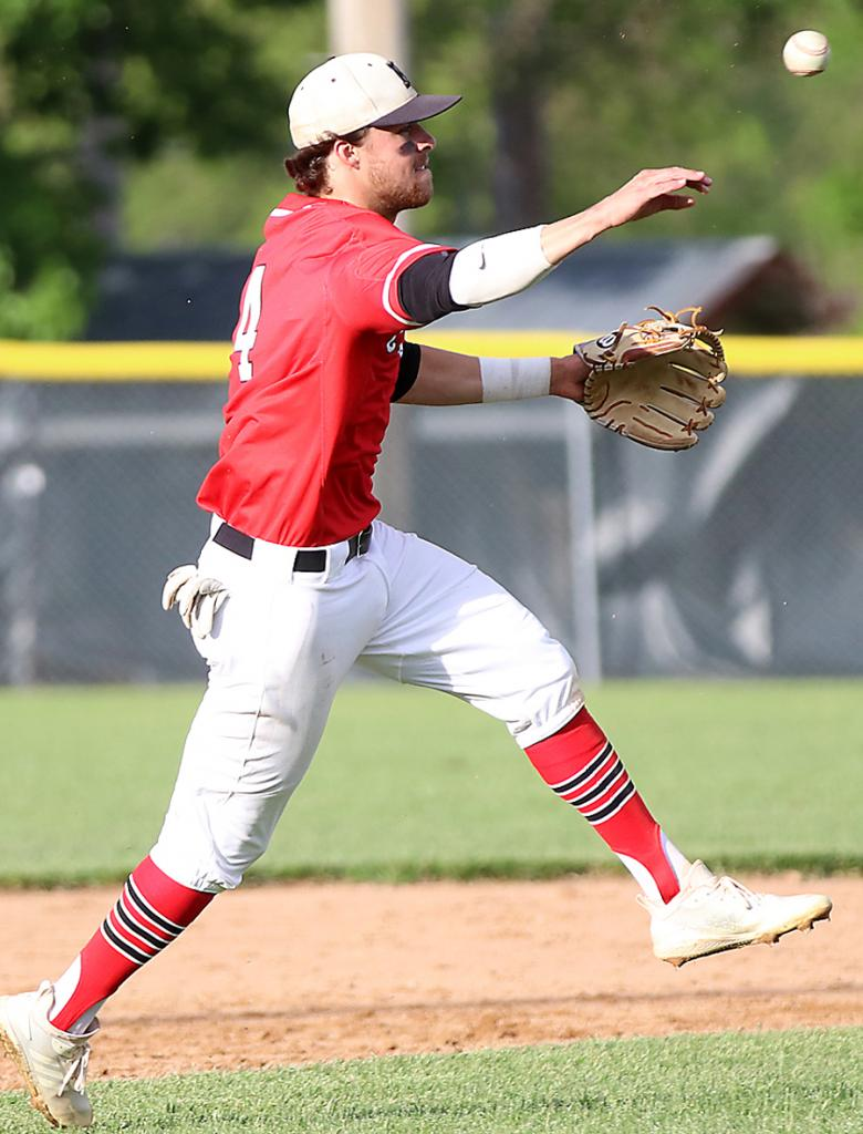 HCHS shortstop Brett Sears throws out a Bishop Heelan runner after charging a slowly-hit ground ball during Friday's 9-6 victory over the Crusaders.
