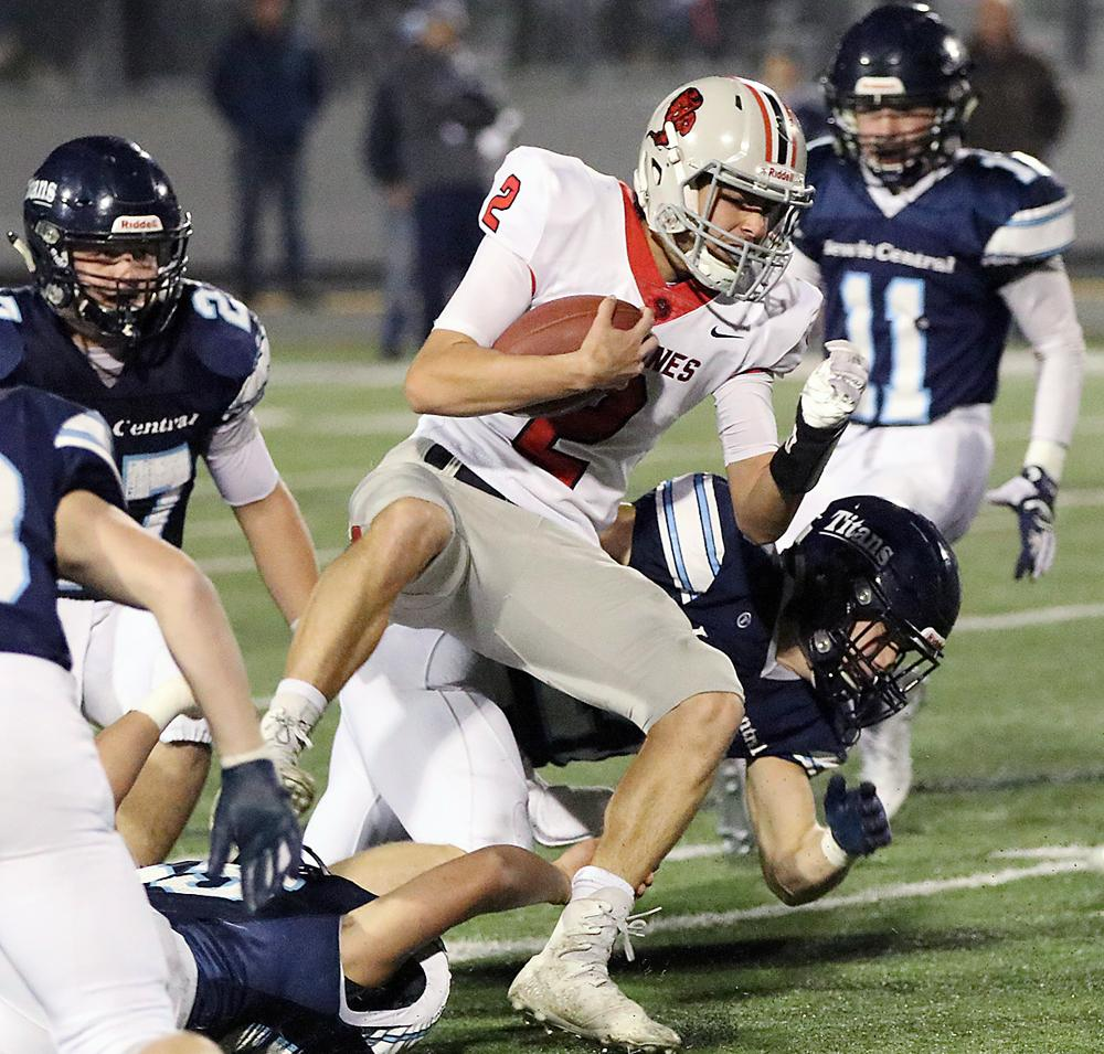 Cyclone senior Brett Sears fights for extra yards against LC.