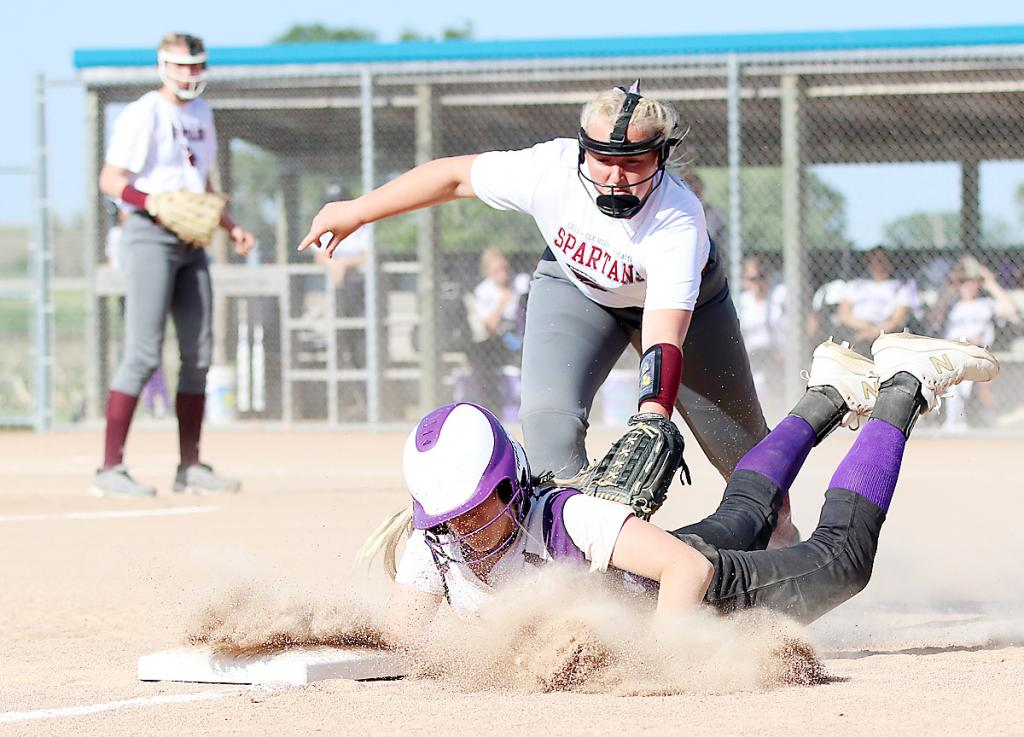 Spartan third baseman Mollie Rasmussen is unable to tag out a Bulldog base runner diving back to the bag.