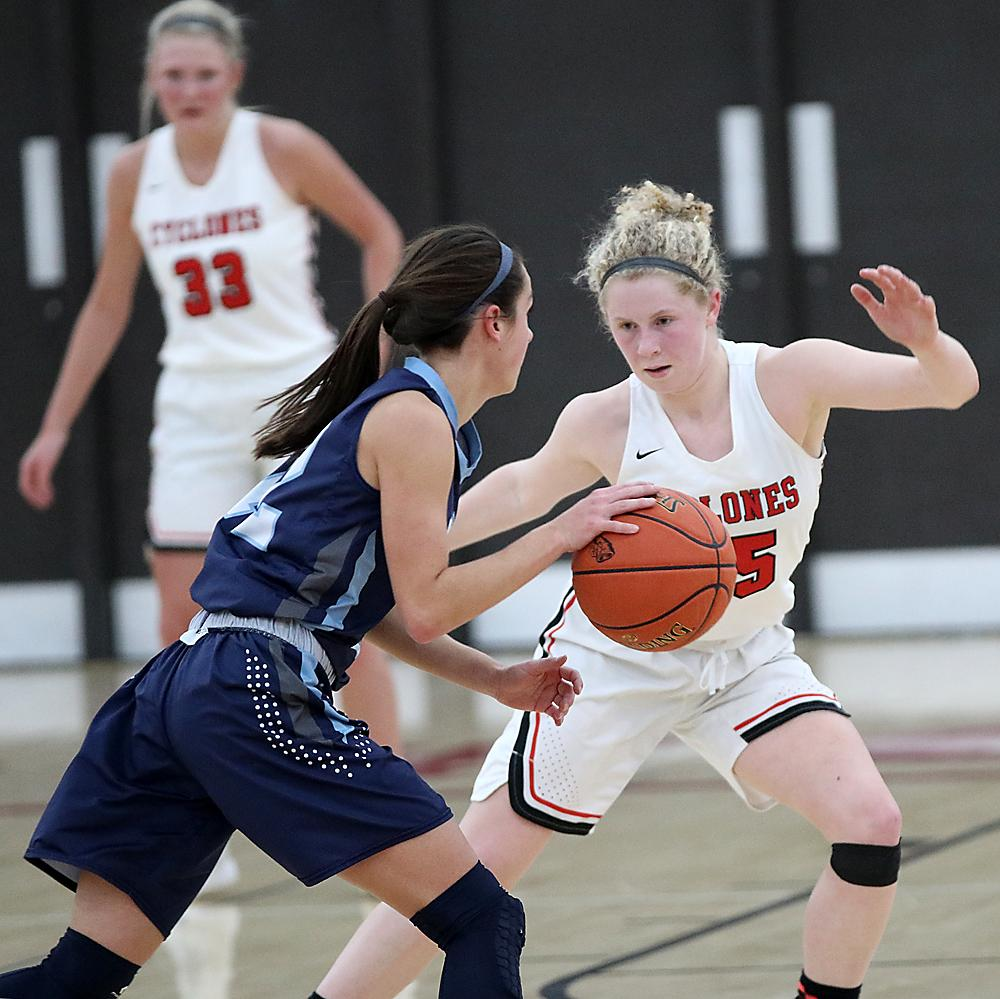 HCHS senior Brecken Van Baale (right) guards Panorama's Payton Beckman at the top of the key as Macie Leinen (33) looks on. Van Baale hounded Beckman for much of the game as the Cyclones held the Panther standout to nine points in a 61-47 victory. (Photos by Mike Oeffner)