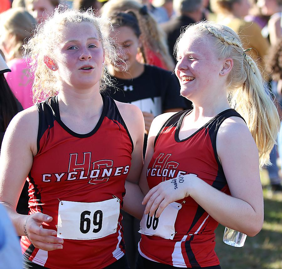 HCHS senior Greichaly Kaster (right) and sophomore Brecken Van Baale, last year's only Cyclone state meet qualifiers, are all smiles following Thursday's race.