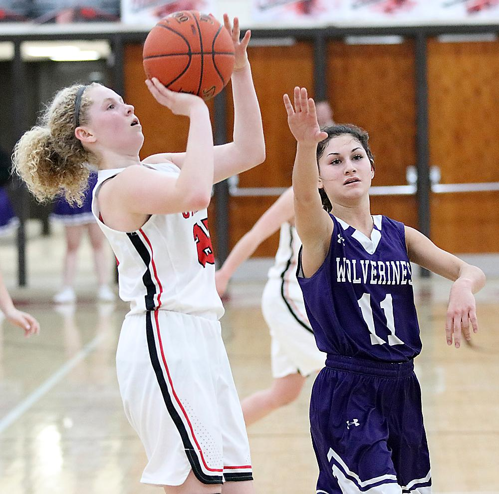 Cyclone sophomore Brecken Van Baale shoots a jumper as Reagan Weinheimer defends for Nodaway Valley. Van Baale scored a game-high 13 points.