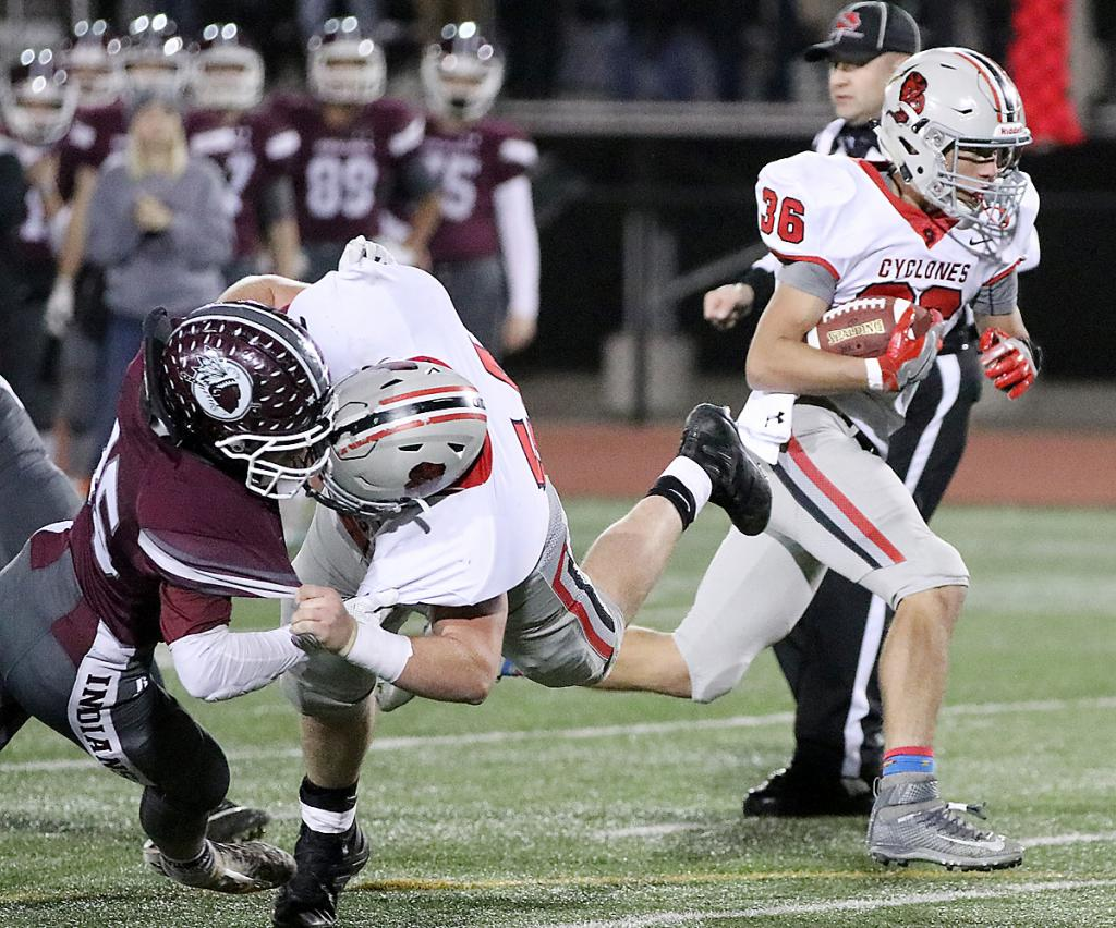 HCHS tailback Brenden Bartley (36) scores a first-quarter touchdown during Friday's Class 3A playoff game as teammate Joey Arkfeld wipes out a potential Oskaloosa tackler.