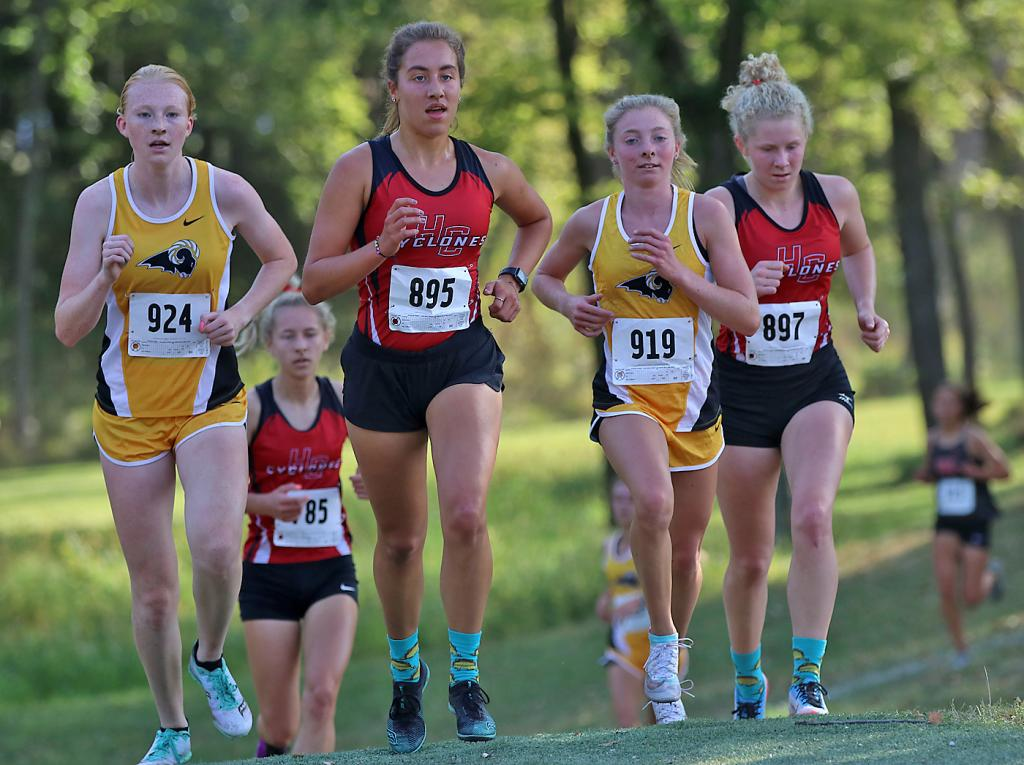 HCHS junior Kaia Bieker (center) and seniors Brecken Van Baale (right) and Liv Freund (background) run with Southeast Polk's Mattison Plummer and Jenna Francois at the Lynx Invite. Bieker finished fourth, Van Baale was sixth and Freund took seventh to lead the Cyclone girls to third place as a team. (Photos by Mike Oeffner)