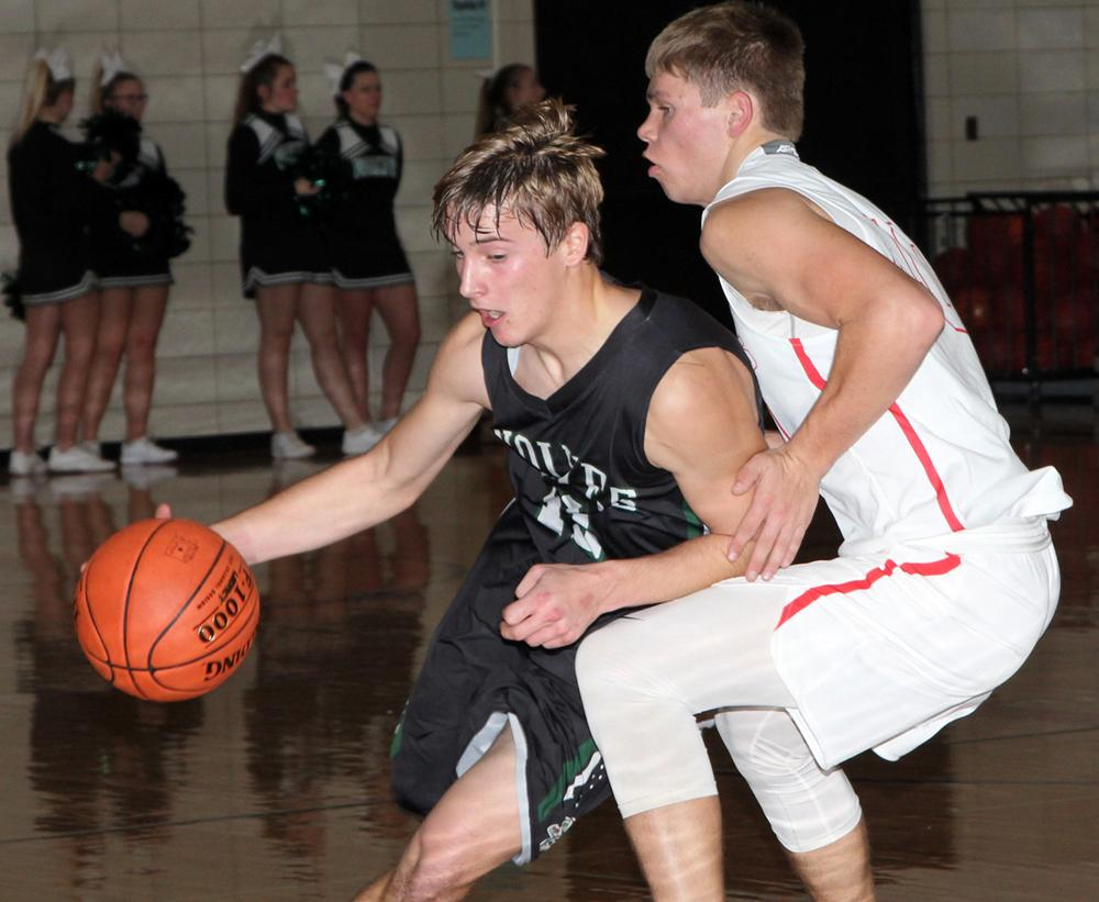 IKM-Manning's Nathan Blankman (left) is guarded by Lane Lawson of Audubon. (Photo by Kim Wegener)