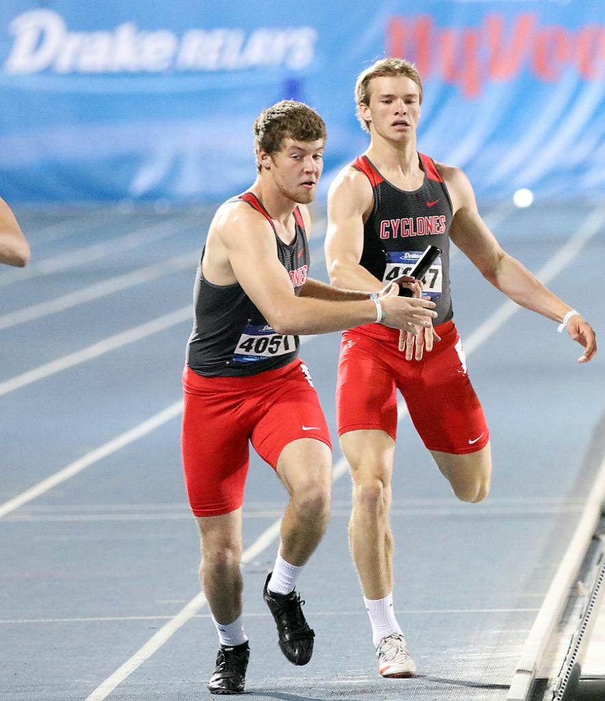HCHS seniors Eli Boldan (right) and Jon Owens make the first exchange in the 4x400 relay during Friday night's session of the Drake Relays. Boldan and Owens teamed with Johnathan Monson and Michael Erlemeier to run a season-best time of 3:25.65 and finished 15th out of 24 qualifiers.