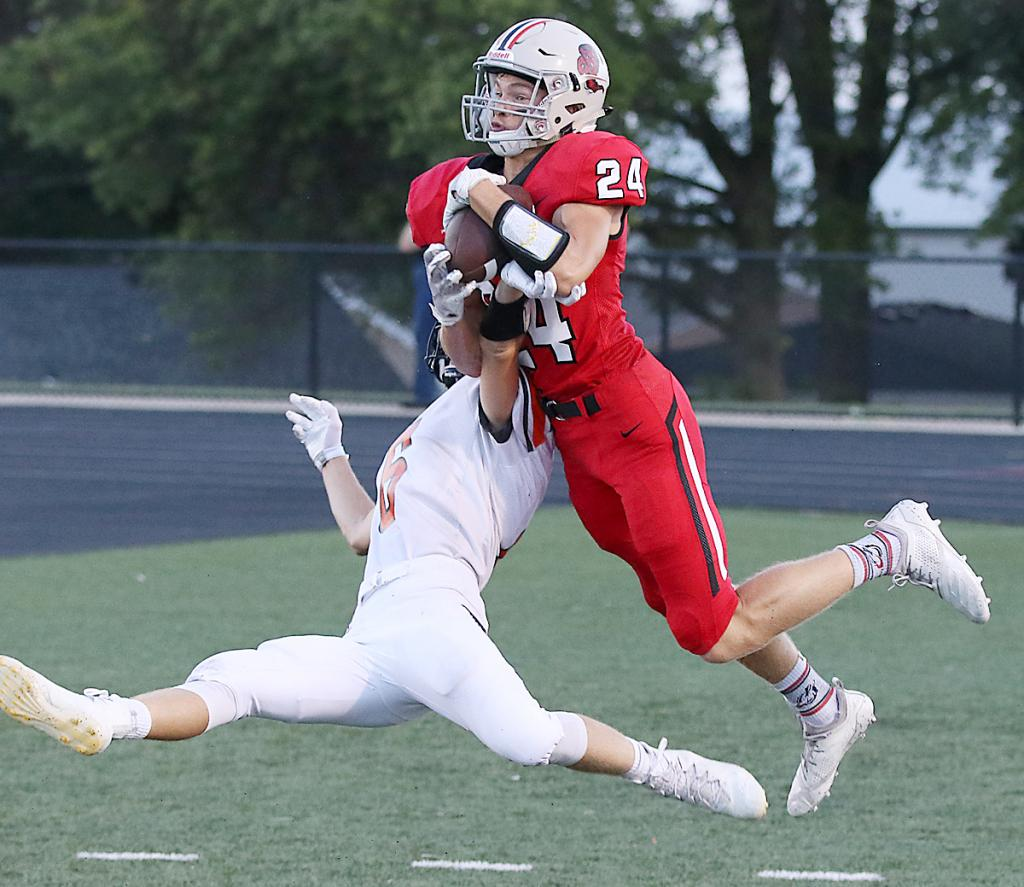 HCHS senior Eli Boldan (24) makes a leaping touchdown catch over Sergeant Bluff-Luton's Deric Fitzgerald in the end zone for his second score of the game. Boldan totaled 181 receiving yards by halftime and finished with seven catches for 186.