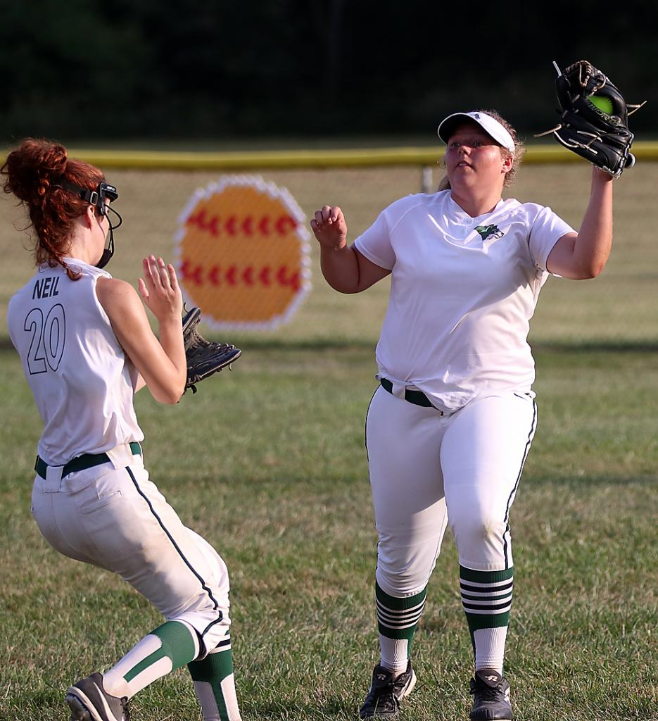 IKM-Manning right fielder Brooke Booth catches a fly ball as second baseman Carlee Neil also tries to make a play on the ball.