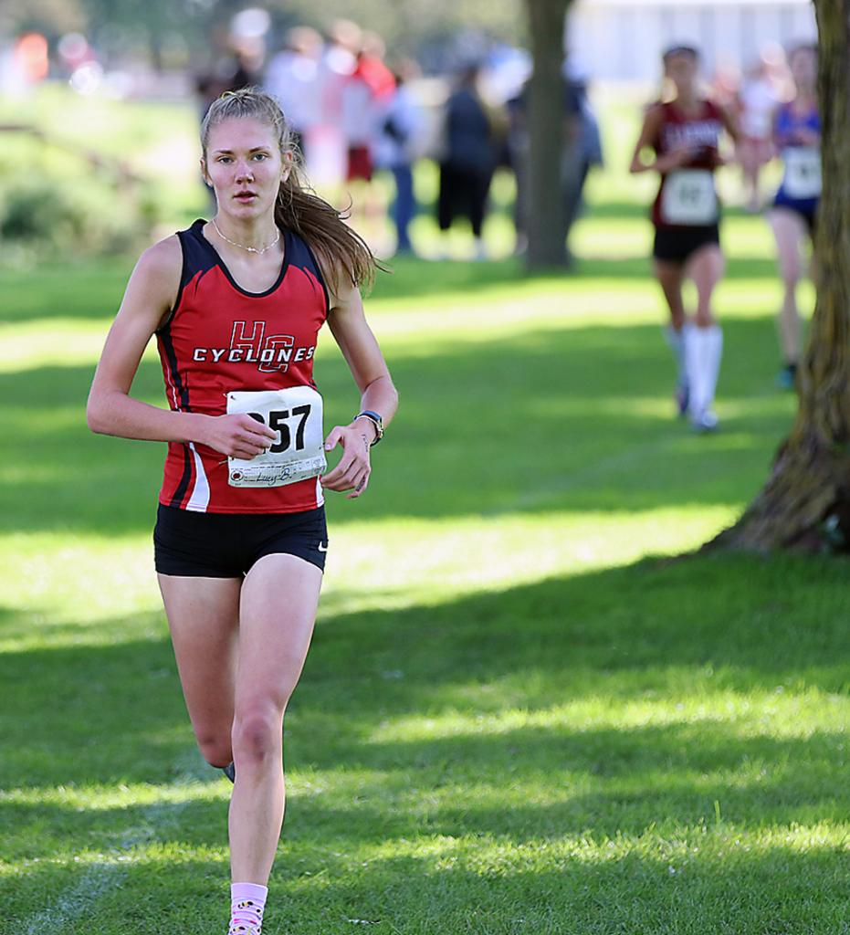 Harlan Community senior Lucy Borkowski takes over first place during Saturday's Cyclone Invite at the Harlan Golf and Country Club. Borkowski pulled away from the field to earn her first individual meet title with a personal-best time of 19:43.