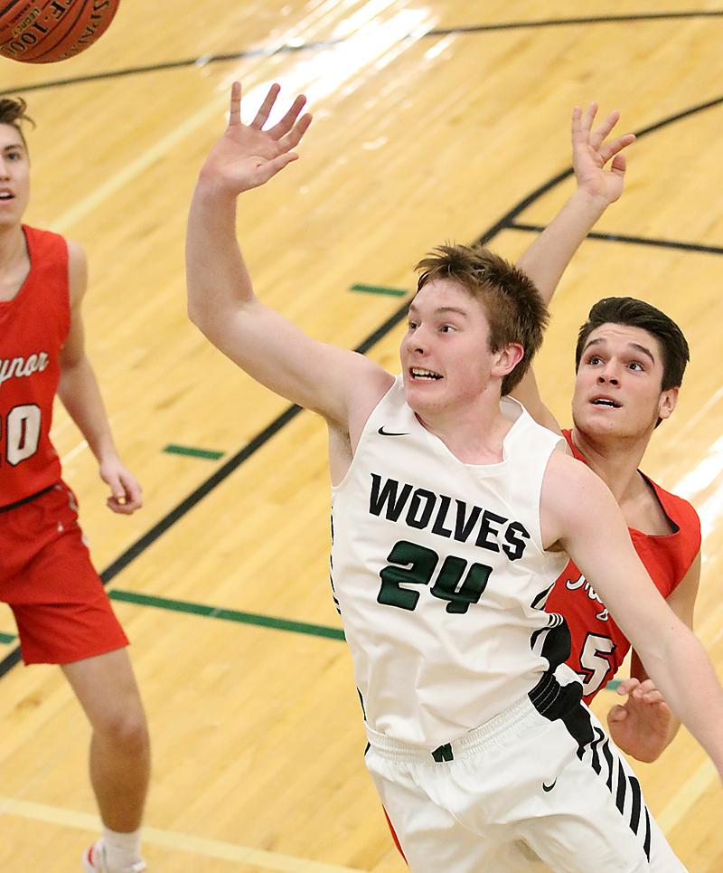 Wolves' junior Colten Brandt (24) shoots a floater in the lane. (Photos by Mike Oeffner)