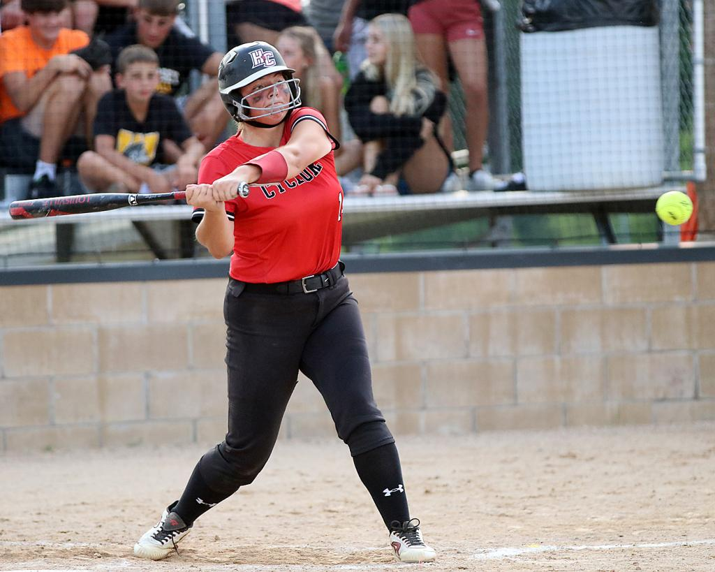 HCHS senior Emily Brouse starts her swing before hitting a line drive against the Huskies.