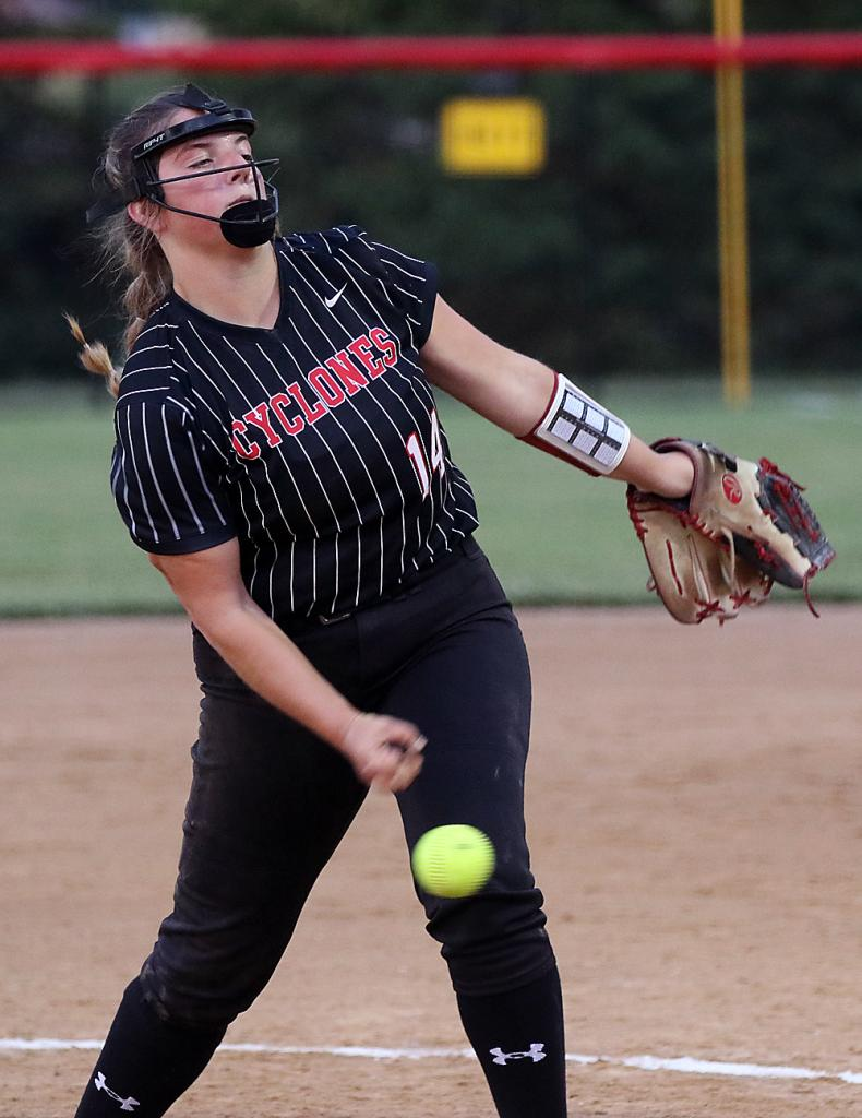 Harlan Community senior Emily Brouse delivers a pitch against Sioux City East during Tuesday's 11-1 Cyclone victory. Brouse earned her 12th pitching win of the year and supported her own cause by going 3-for-3 with two home runs at the plate.