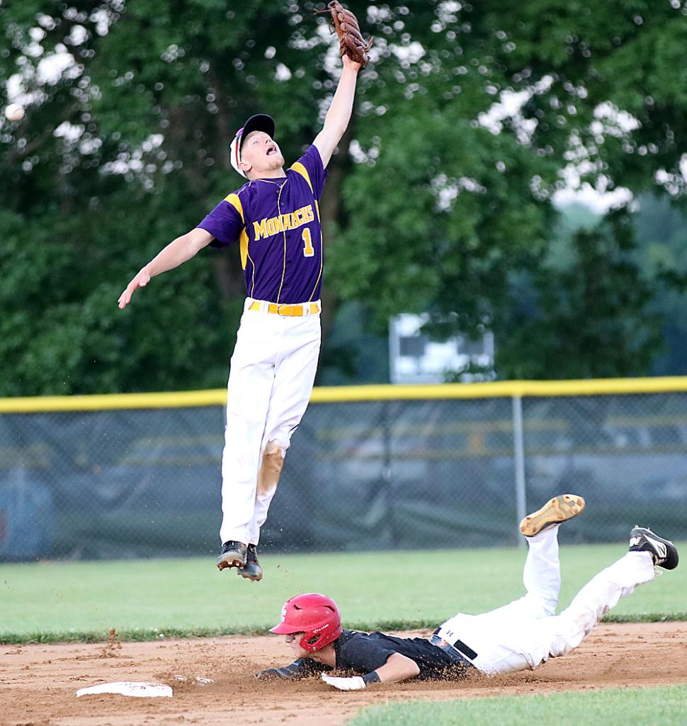 Cyclone senior Connor Bruck slides safely into second with a stolen base as Denison's Jack Mendlik tries to make a leaping catch during Monday's game. (Photos by Mike Oeffner)