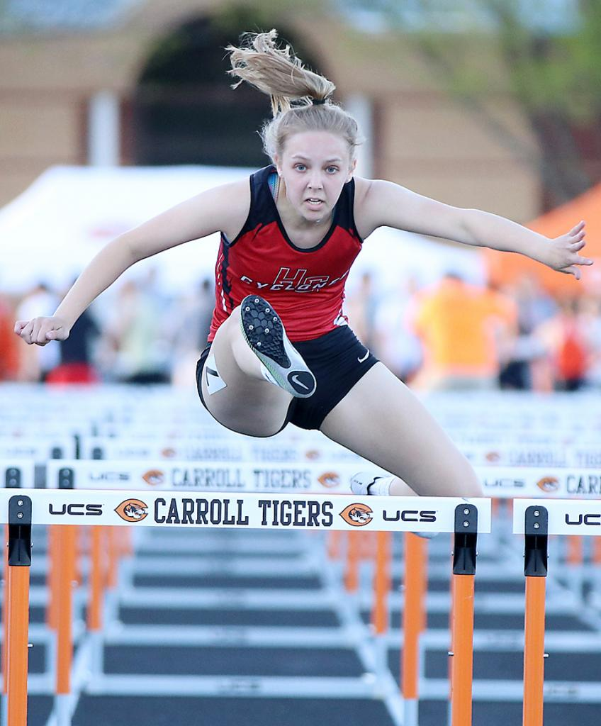 HCHS sophomore Justine Buman competes in the 100-meter hurdles.