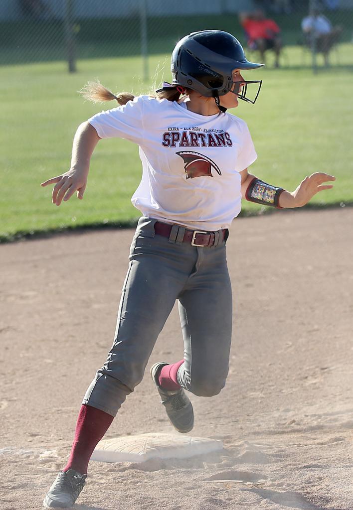 Shay Burmeister surveys the field as she rounds third base before scoring a Spartan run.