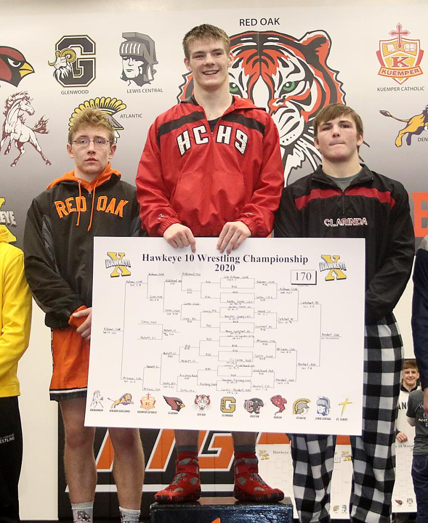 CONFERENCE CHAMP -- Carter Bendorf stands atop the medal podium following the meet. Also pictured are Bruce Lukehart (left) and Clarinda's Cole Ridnour, who placed third. (Photos by Mike Oeffner)