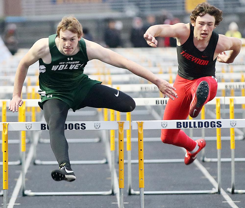 IKM-Manning's Colten Brandt (left) placed third in the 110-meter hurdles with a personal-best time of 15.96.