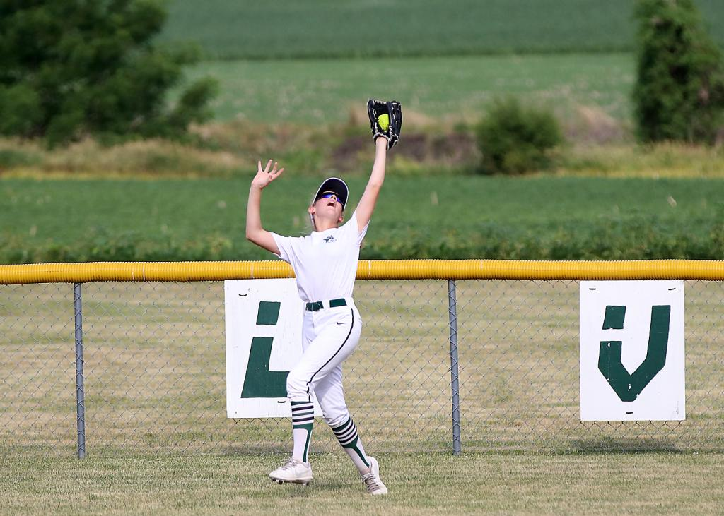 IKM-M center fielder Carlee Neil reaches back to make a nice catch in front of the fence against Logan-Magnolia. (Photos by Mike Oeffner)