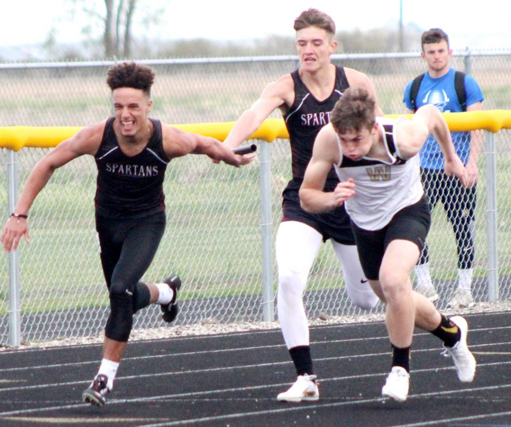 Exira-EHK senior Jayden Goodwin (left) takes a handoff from junior Creighton Nelson in the 4x200 relay at Monday's Rolling Valley Conference Track Meet. Goodwin and Nelson teamed with Cole Burmeister and Trever Schulz to place second in the event. (Photos courtesy of Matt Gengler, Missouri Valley Times)
