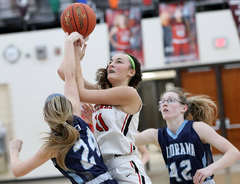 Cyclone junior Claire Schmitz shoots over the Panthers' Laci Rishel (24) as Jaidyn Sellers (42) also defends.