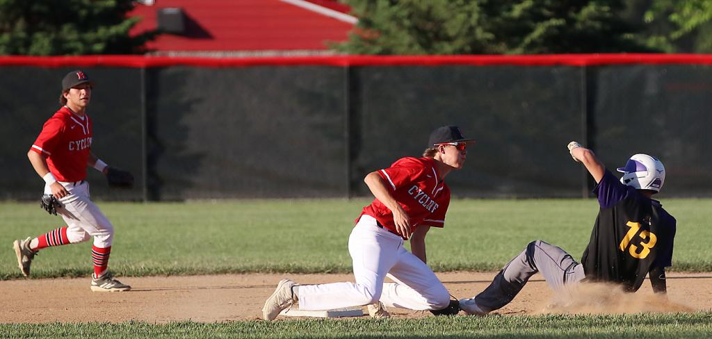 HCHS second baseman Cade Sears tags out Denison's Evan Turin attempting to steal in the first inning of Tuesday's 12-2 Cyclone victory.