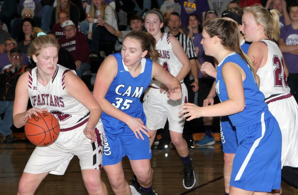 E-EHK senior Leslie Caniglia handles the ball as Macy Ticknor defends for CAM. Caniglia scored 10 points in the Spartans' 58-55 victory. (Photos by Kim Wegener)