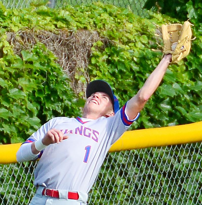 Viking left fielder Joey Cunningham makes a nice catch near the fence against IKM-Manning.