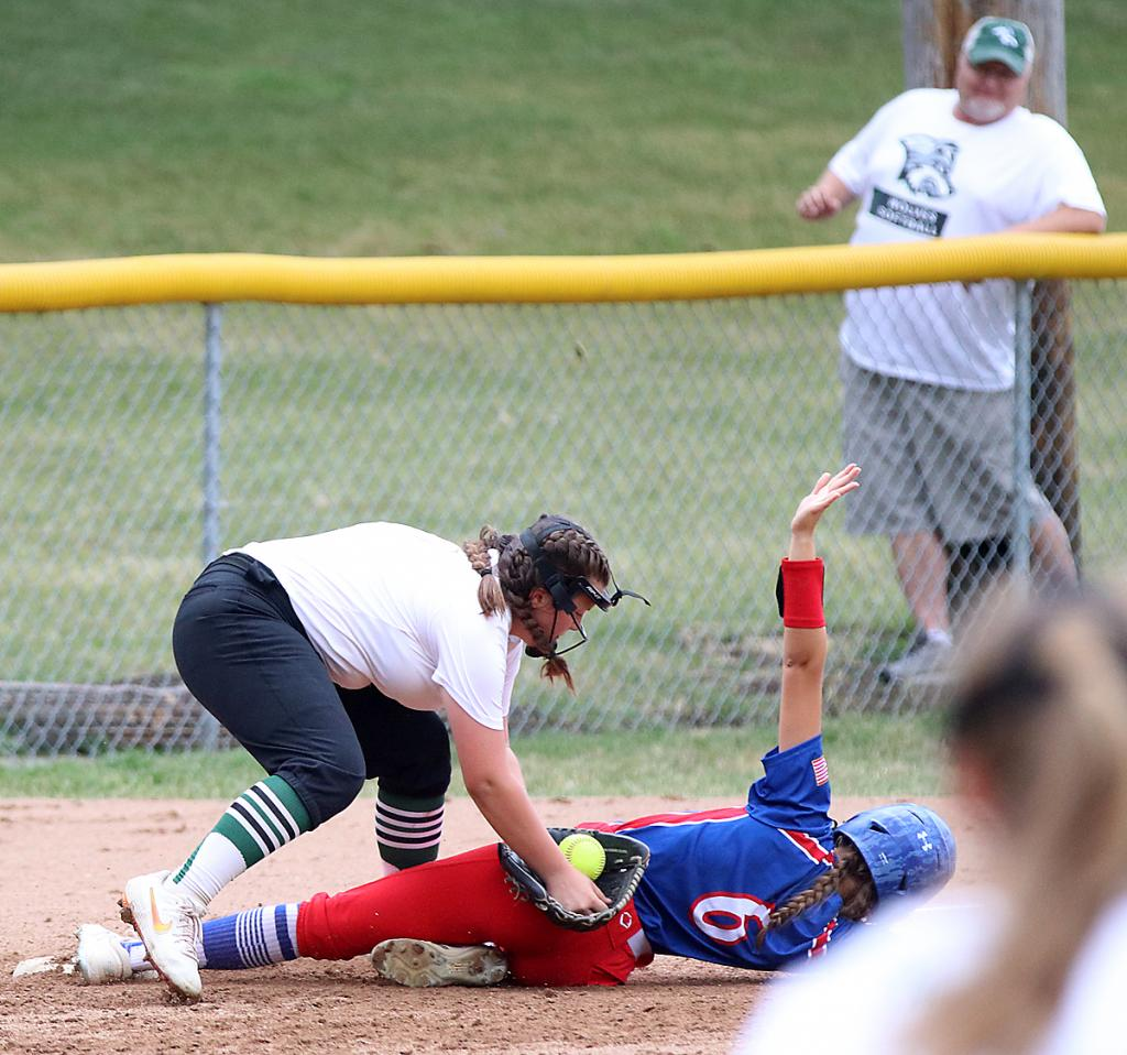 IKM-Manning third baseman Lauren Greving (left) tags out AHSTW's Ella Langer during Thursday's Western Iowa Conference game.