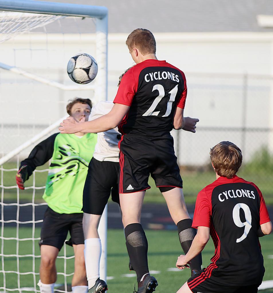 Cyclone junior Cody Christensen (21) scores a header goal off Cole Kramer's assist. Also pictured for HCHS is Jordan Fink (9).