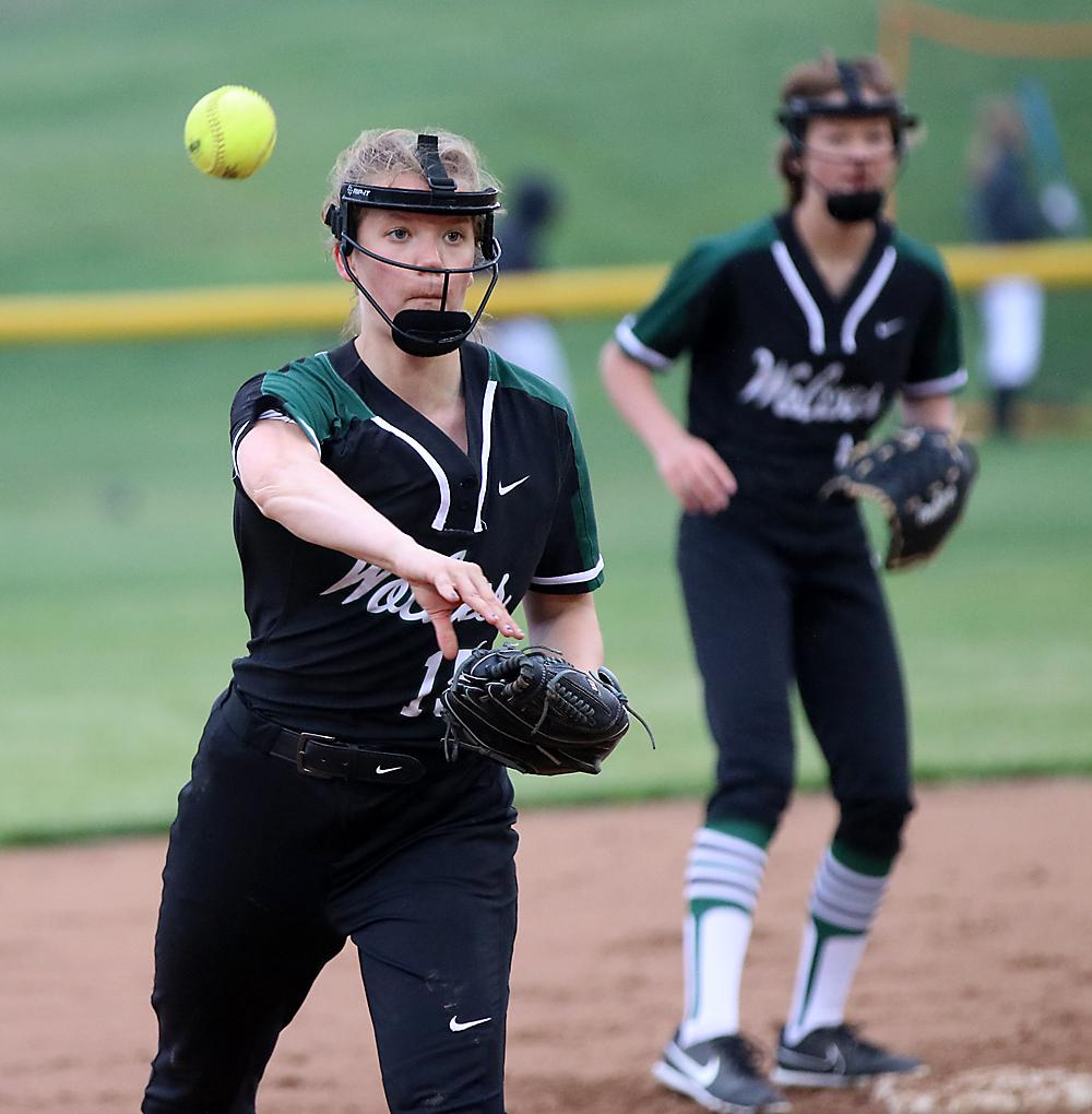 Wolves' shortstop Jessica Christensen throws to third for a force out.
