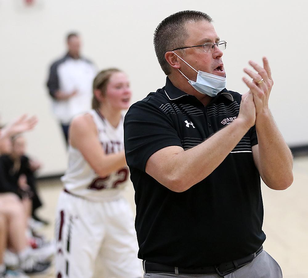 Spartan head coach Tom Petersen encourages the team.