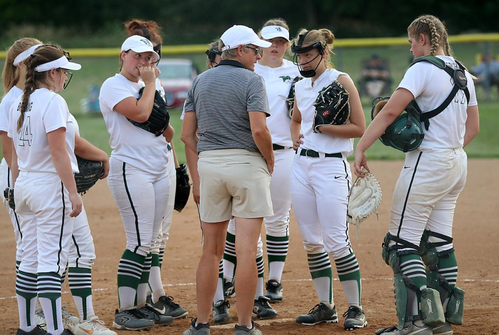 IKM-Manning softball coach Joy Gross talks to her team on the field during last Tuesday's 11-0 regional tournament loss at ACGC. The Wolves finished 0-21. (Photos by Mike Oeffner)