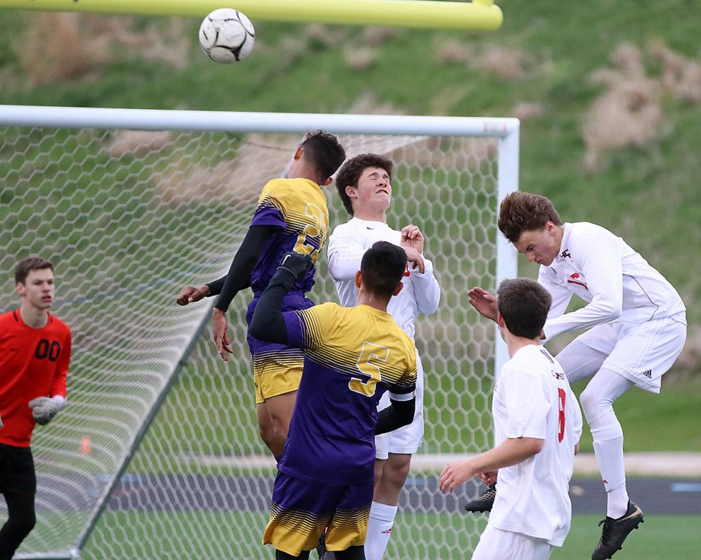HCHS junior Michael Heithoff (right) and sophomore Jacob Schechinger (center) try to get a head on the ball during a Denison corner kick Monday night. Also pictured for the Cyclones are goalie Konner Leinen (00) and Joe Devine.